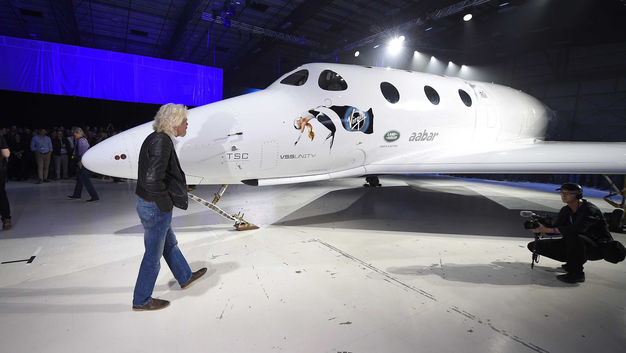 Sir Richard Branson walks in front of Virgin Galactic's space tourism rocket after it was unveiled in February 2016, in Mojave, Calif.
