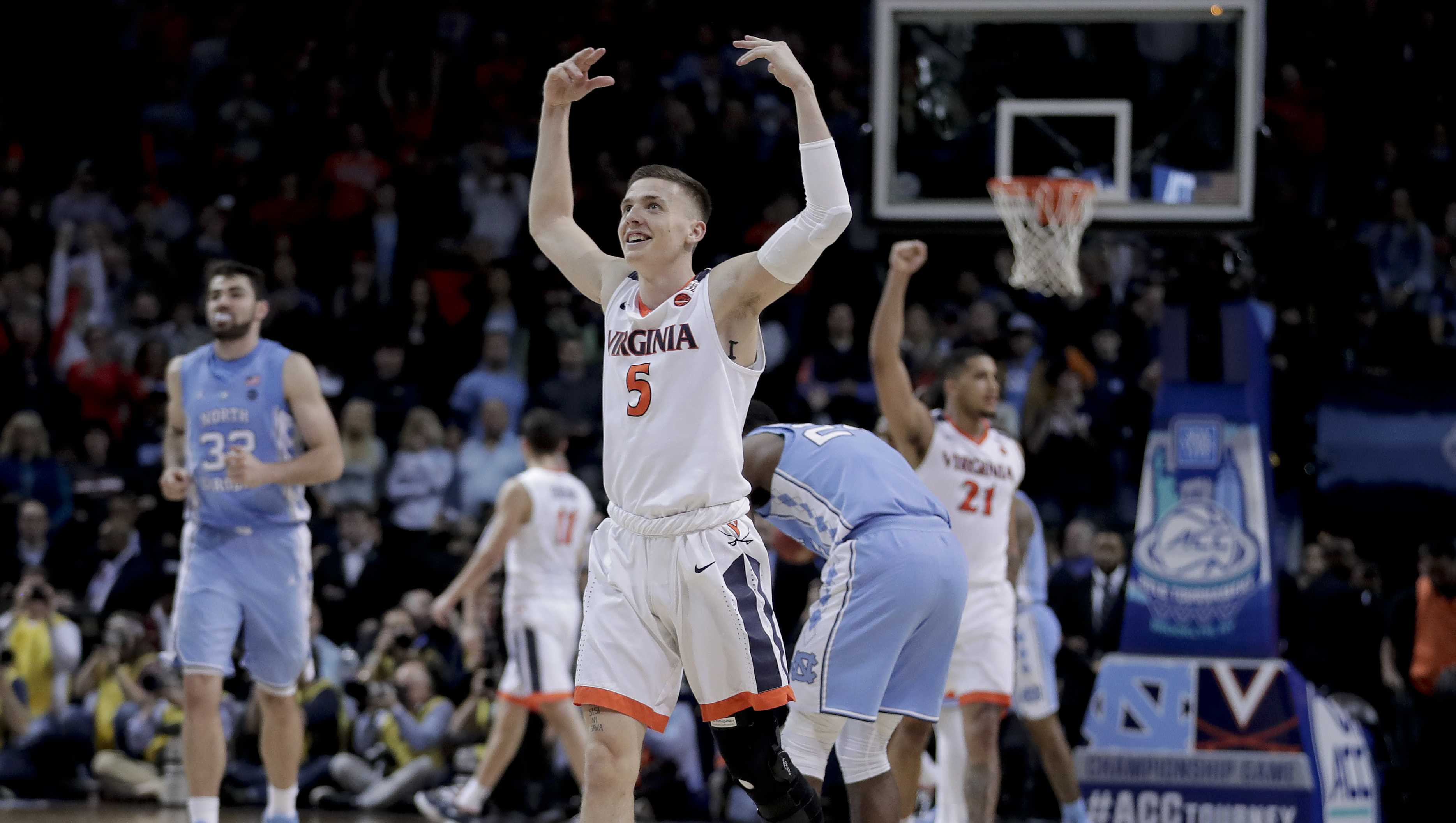 Virginia guard Kyle Guy (5) celebrates as the final seconds wind off the clock against North Carolina in the championship game of an NCAA college basketball game during the Atlantic Coast Conference men's tournament Saturday, March 10, 2018, in New York.