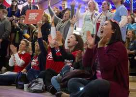 Virginia Democrats cheer as vote numbers are announced for the Presidential race during an election party in Falls Church, Va.