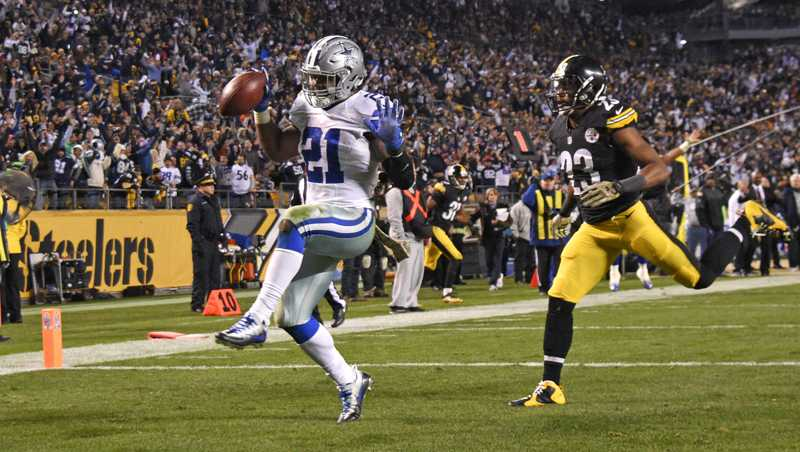 Cowboys running back Ezekiel Elliott dances into the end zone ahead of Mike Mitchell for a game-winning touchdown against the Steelers.
