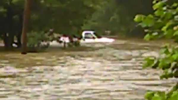 A vehicle became stuck in flood waters in Hopwood, Fayette County.