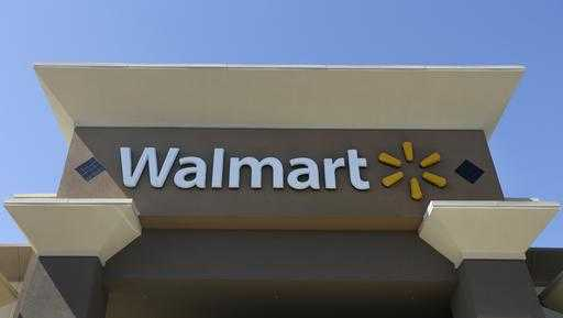 This Sept. 19, 2013, file photo, shows the sign of a Wal-Mart store in San Jose, Calif.