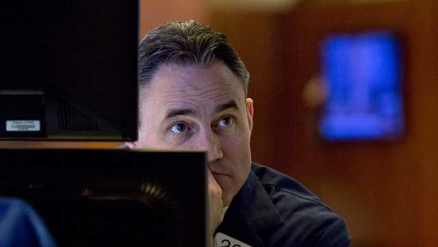 Specialist Jason Hardzewicz works on the floor of the New York Stock Exchange, Thursday, March 22, 2018.