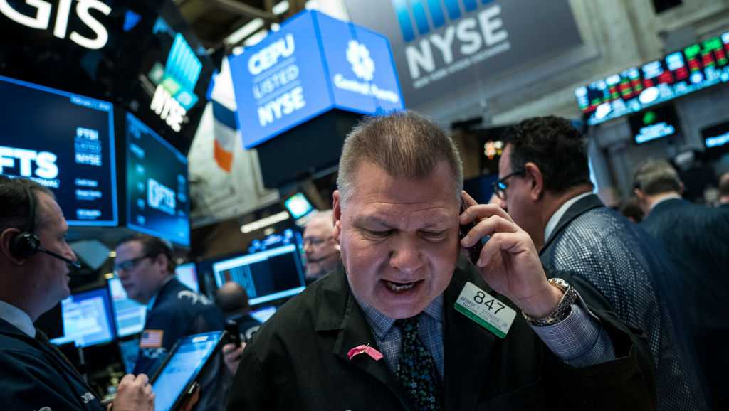 Traders and financial professionals work on the floor of the New York Stock Exchange (NYSE) ahead of the opening bell, February 2, 2018 in New York City. The Dow dropped 250 points at the open on Friday morning.