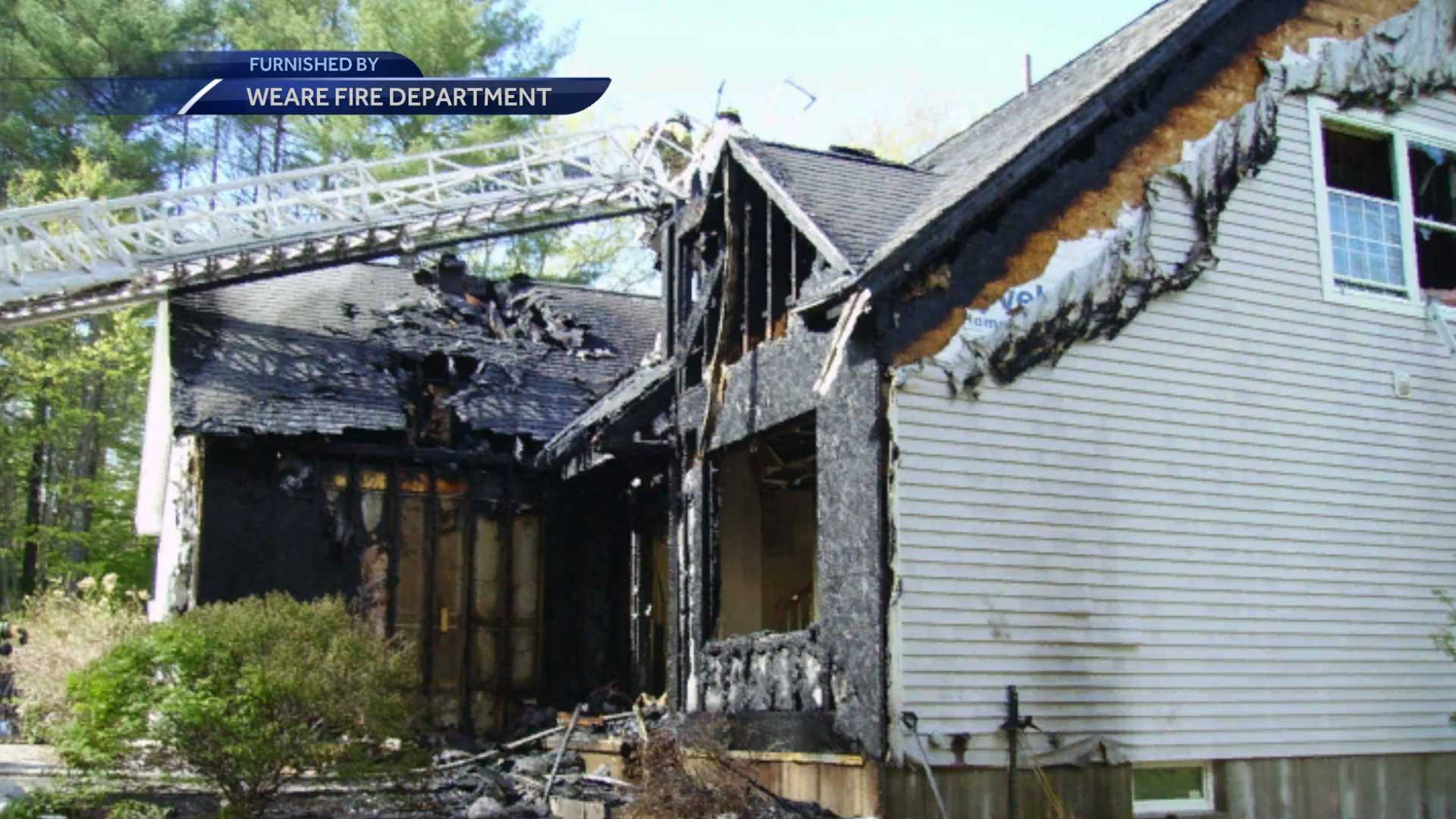 Two-alarm fire damages Weare home