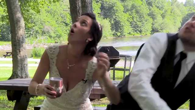 A couple dodged a falling tree branch after their wedding ceremony while they were sitting on a picnic table.
