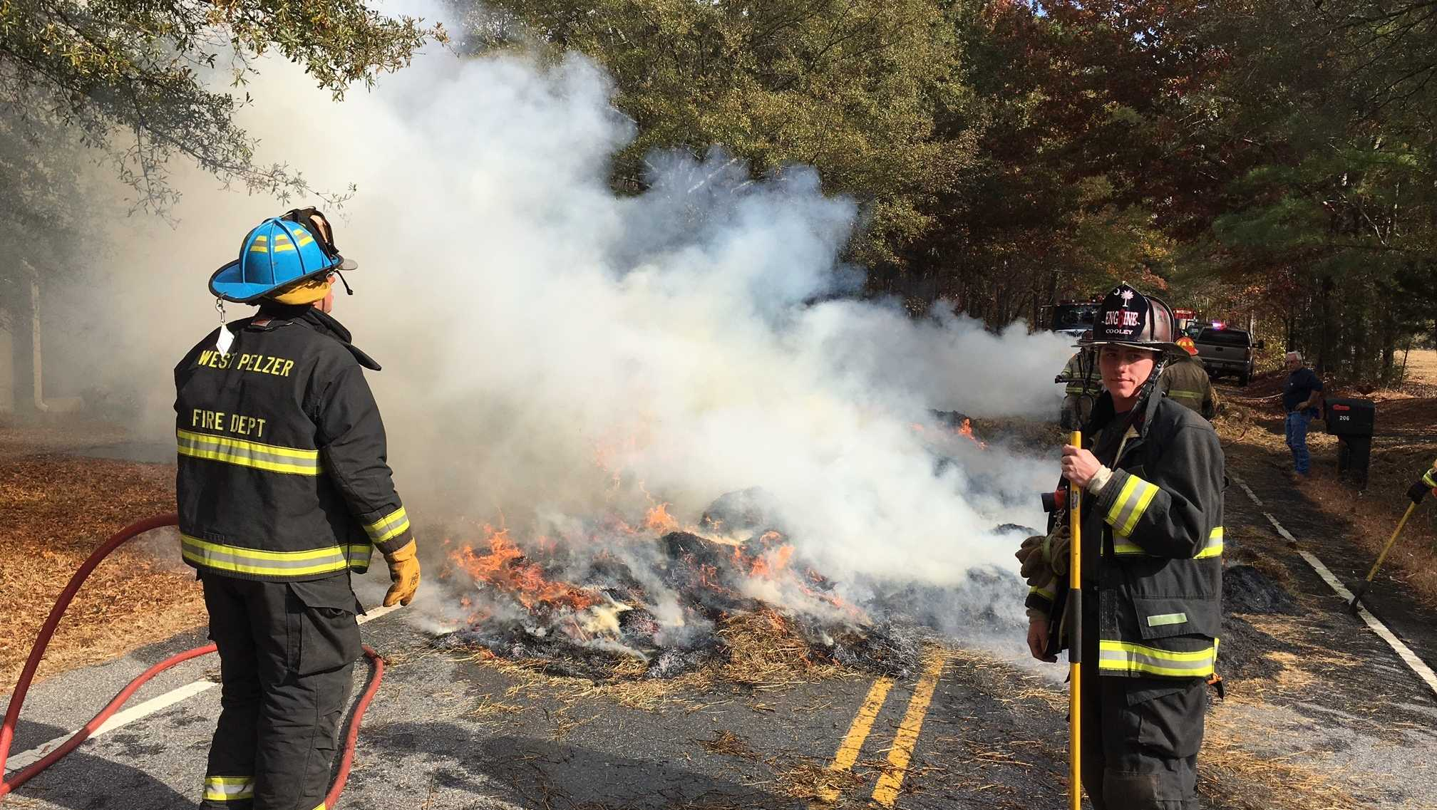Welcome Road is shut down after hay bales catch fire