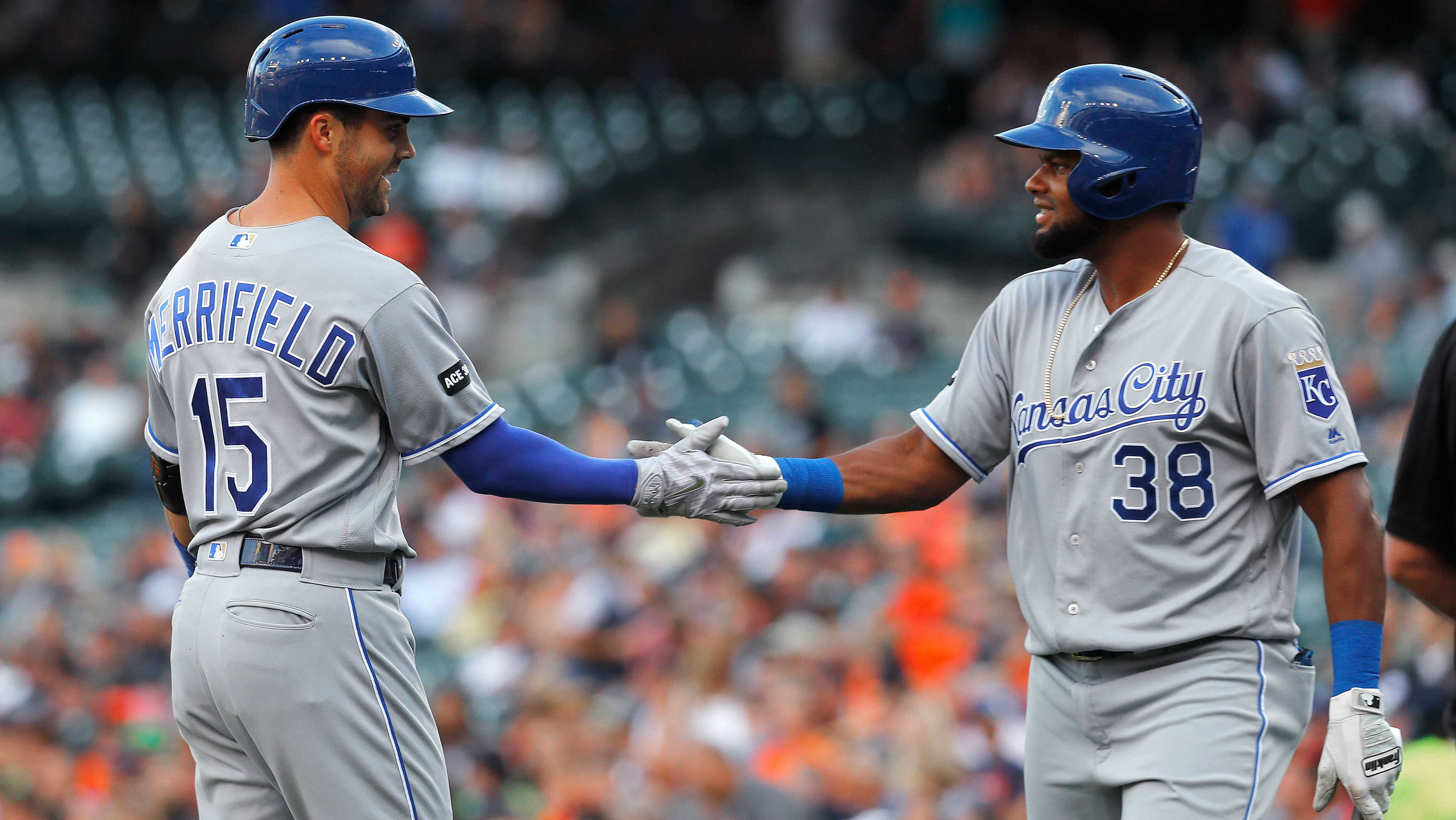 Kansas City Royals' Whit Merrifield (15) celebrates his lead off solo home run with Jorge Bonifacio (38) against the Detroit Tigers in the first inning of a baseball game in Detroit, Tuesday, July 25, 2017. (AP Photo/Paul Sancya)