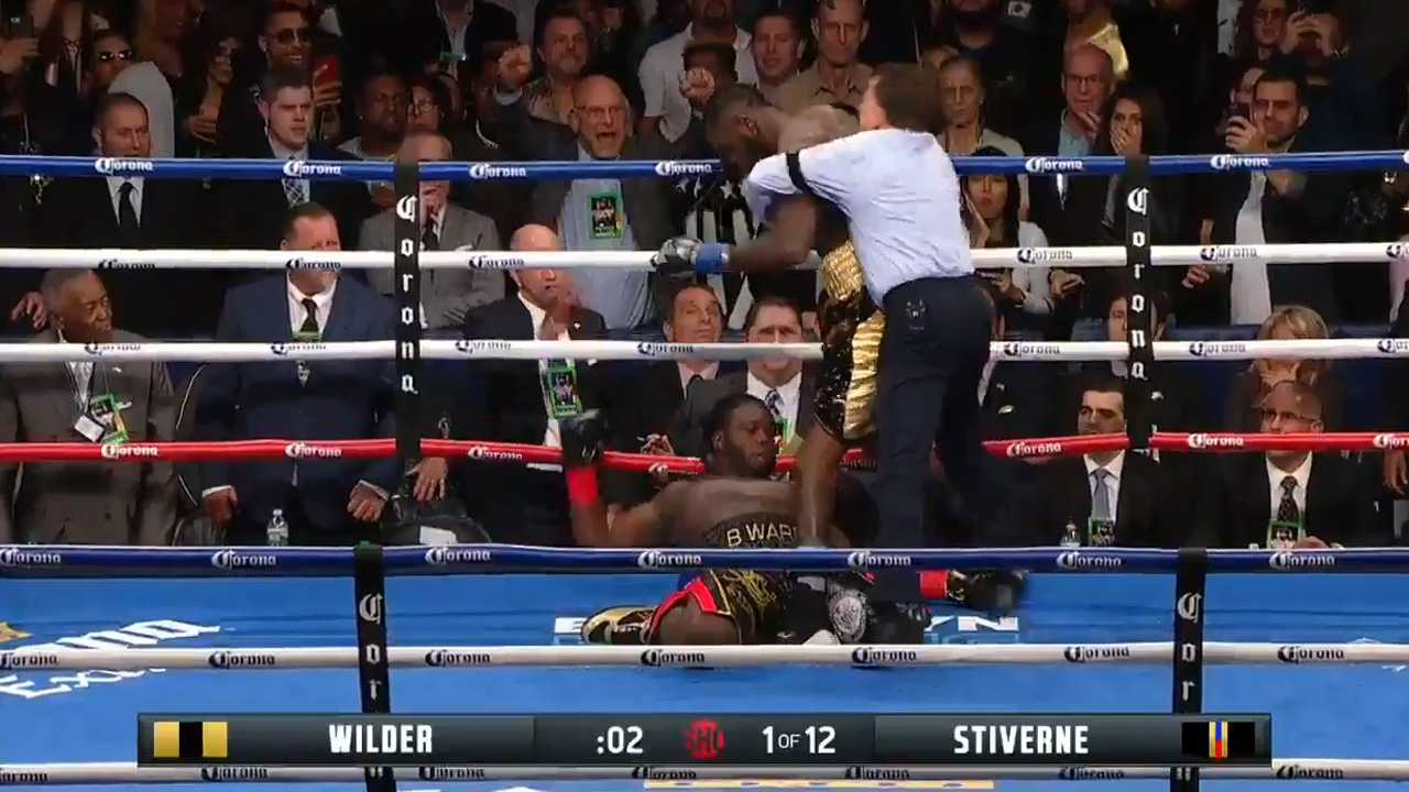Deontay Wilder knocked out the only man who'd ever gone the distance with him, sending Berman Stiverne to the canvas three times in the opening round to defend his WBC heavyweight title Saturday night at Barclays Center.