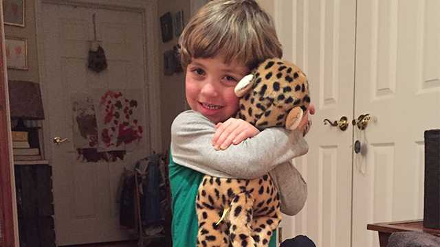 Will Ketcher hugs a stuffed animal that he receivedfrom Rhode Island State Police.