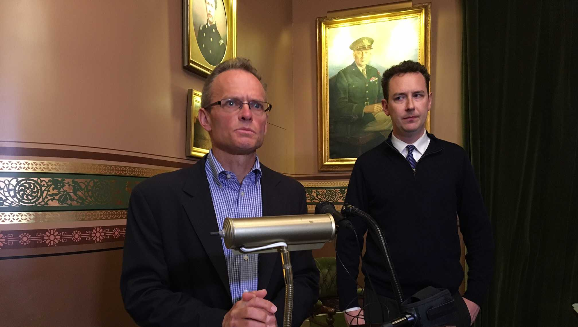 Democratic Party leaders Willem Jewett and Conor Casey hold a news conference at the Statehouse.