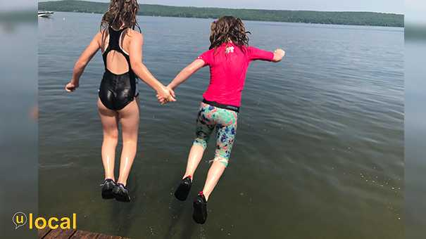 My girls loved jumping into lake Metonga together. This one with their hands held is my favorite.
