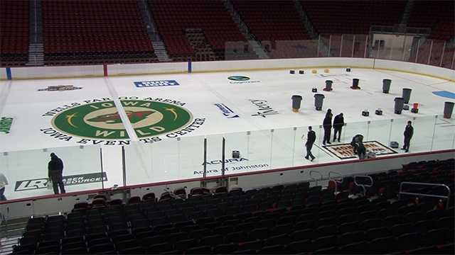 Crews prepare the arena for new ice for the 2016 hockey season.