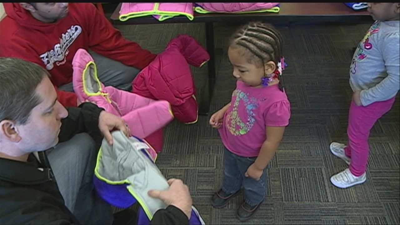 Firefighters were on hand to deliver warm coats to children at Conestoga Elementary on Tuesday.