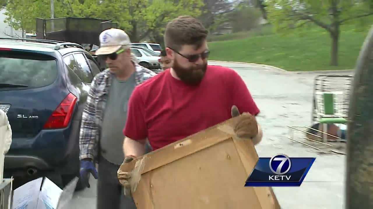 Good weather brings good neighbors out to help clean up Omaha block by block
