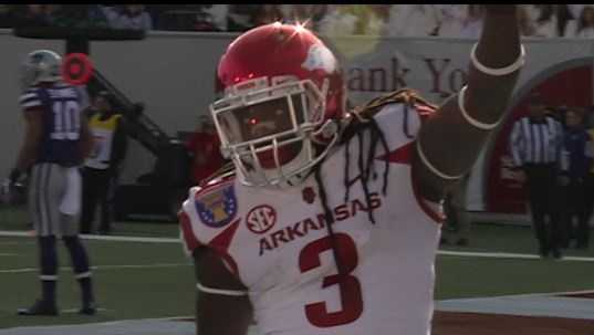 Arkansas running back Alex Collins celebrates after touchdown during Liberty Bowl
