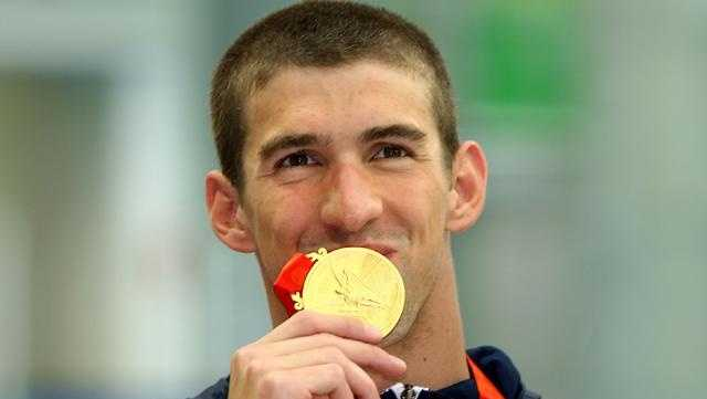 Michael Phelps of the United States poses with the gold medal during the medal ceremony for the Men's 4 x 100m Freestyle Relay held at the National Aquatics Center on Day 3 of the Beijing 2008 Olympic Games on August 11, 2008 in Beijing, China.