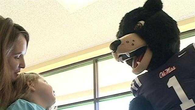Slideshow: Rebel Greets Children At Blair E. Batson