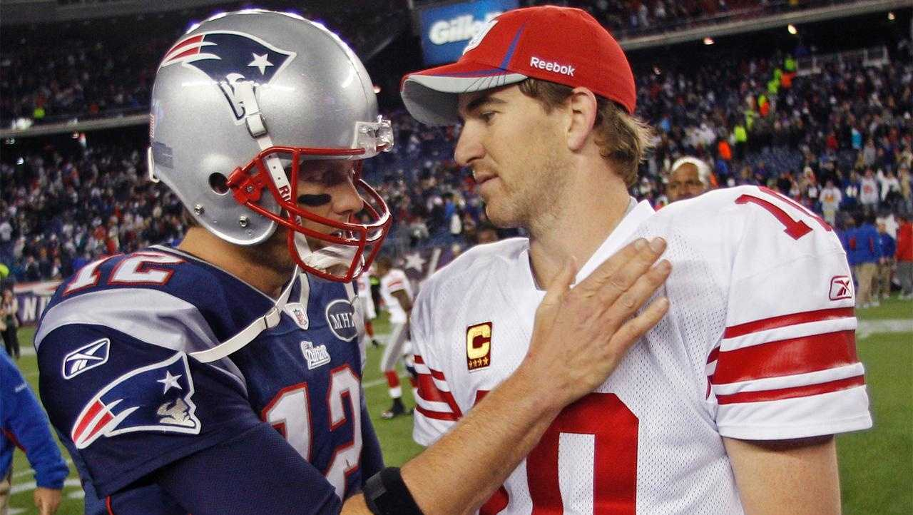 New York Giants' Eli Manning is congratulated by Tom Brady after the Giants' 24-20 win.