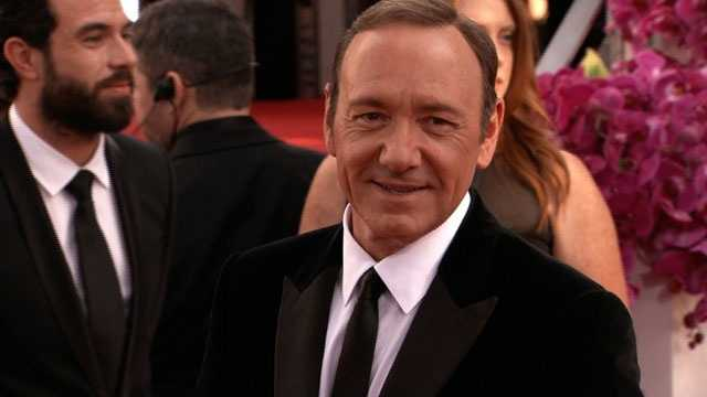 Ex-news reader says Spacey assaulted son