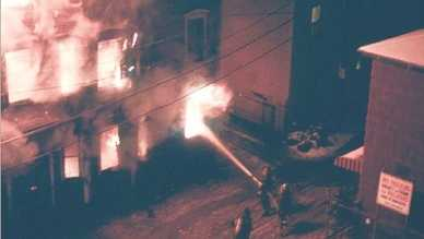 Lowell firefighters battle a five-alarm blaze on Decatur Street in the Acre section in March 1982 that left eight people dead.
