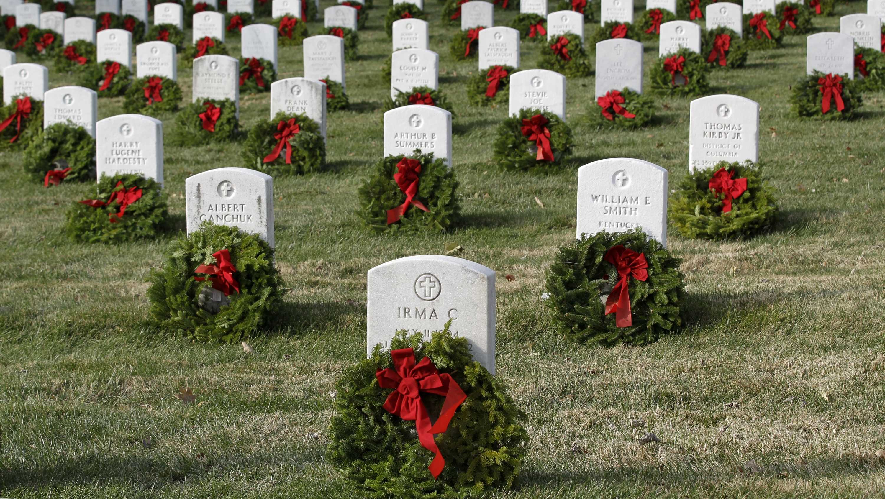 Holiday wreaths adorn tombstones during Wreaths Across America's 150th anniversary, Saturday, Dec. 13, 2014, at Arlington National Cemetery in Arlington, Va.