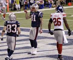 New England Patriots tight end Aaron Hernandez celebrates after scoring a touchdown on a 12-yard pass during the second half of the NFL Super Bowl XLVI football game Sunday, Feb. 5, 2012, in Indianapolis.