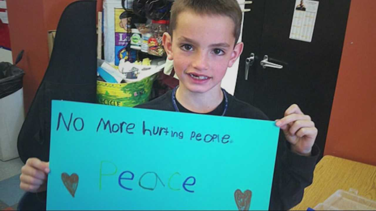 """An enduring image from the aftermath of the Boston Marathon bombings is a photo of 8-year-old Martin Richard holding a sign that reads """"No more hurting people. Peace."""""""