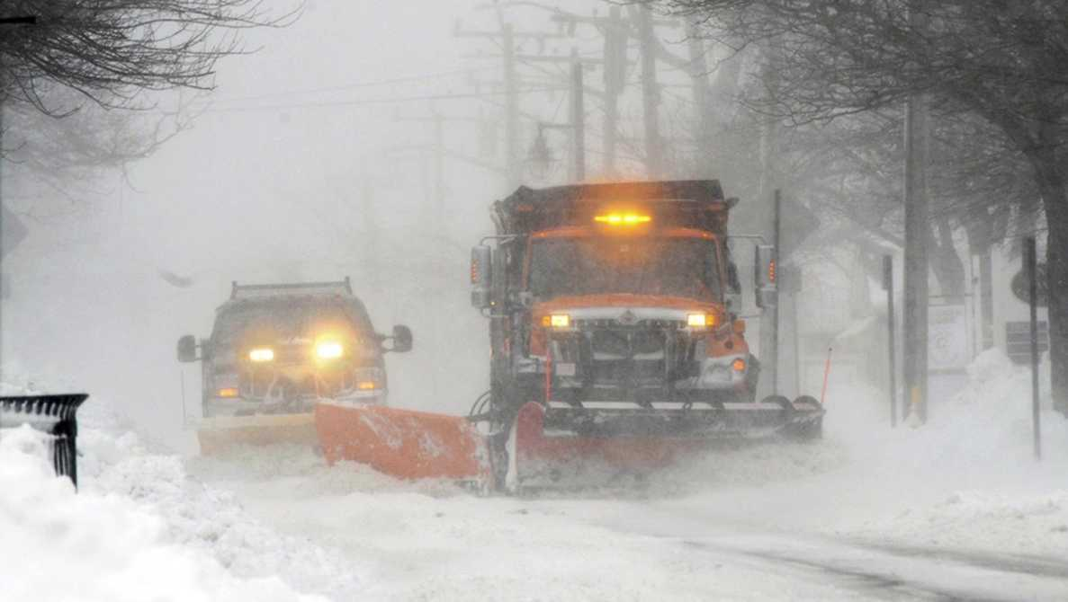 Plows move snow off Main street in Hyannis, Mass., Monday, Feb. 8, 2016. A wind-driven winter storm brought blizzard conditions to Cape Cod and threatened to drop up to 18 inches of snow on southeastern Massachusetts on Monday.
