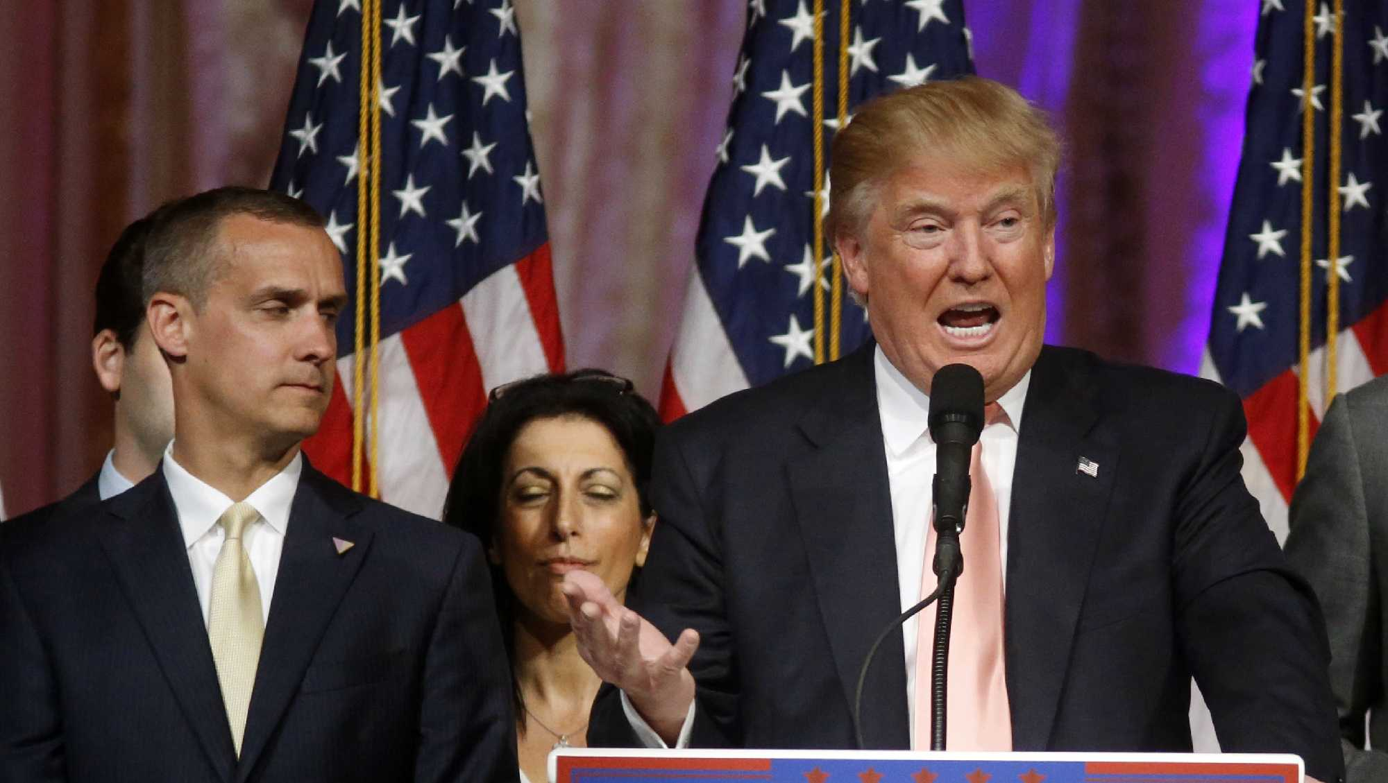 Republican presidential candidate Donald Trump speaks to supporters at his primary election night event at his Mar-a-Lago Club in Palm Beach, Fla., Tuesday, March 15, 2016. At left is his campaign manager Corey Lewandowski.