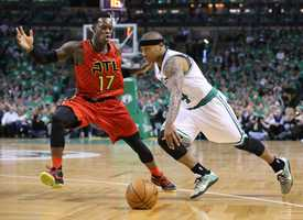 Atlanta Hawks Dennis Schroder guards against Celtics Isaiah Thomas during the first half in Game 4 of a first-round NBA basketball playoff series in Boston on Sunday, April 24, 2016.