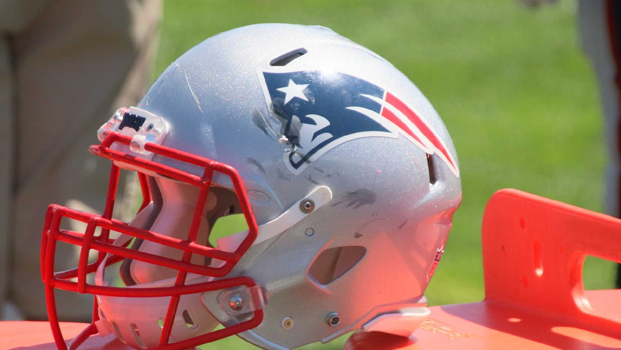 A Patriots player helmet shows some scuff marks after practice Tuesday.