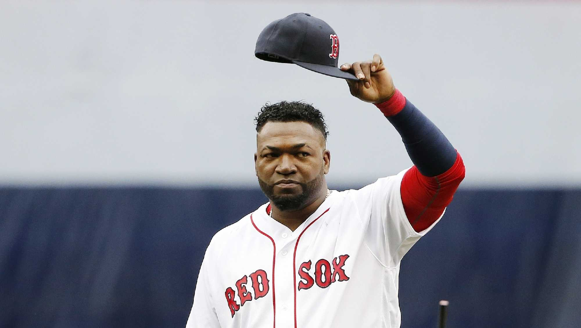 Boston Red Sox's David Ortiz tips his cap to the crowd during ceremonies before a baseball game against the Toronto Blue Jays in Boston, Sunday, Oct. 2, 2016.