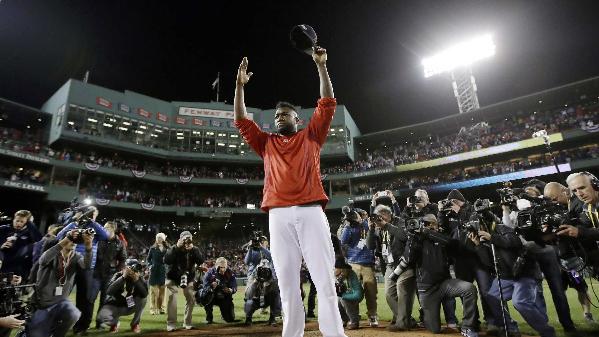 Boston Red Sox's David Ortiz stands on the mound at Fenway Park after Game 3 of baseball's American League Division Series against the Cleveland Indians, Monday, Oct. 10, 2016, in Boston. The Indians won 4-3 to sweep the Red Sox in the series. Ortiz said he will retire at the end of the season.