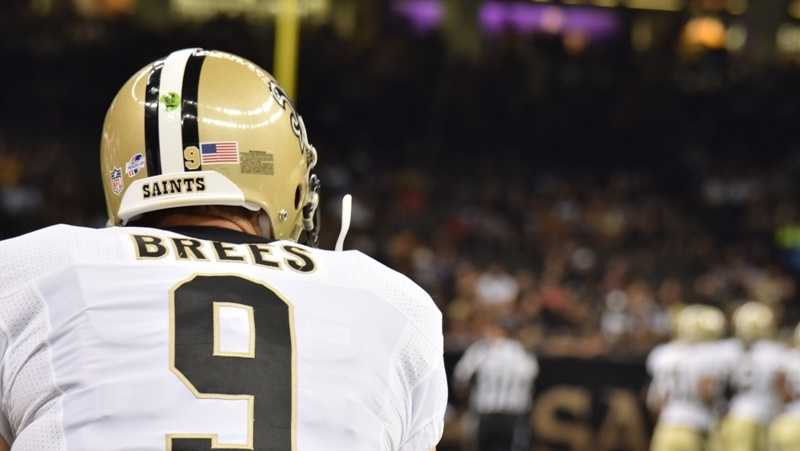 Drew Brees watches the action from the sideline