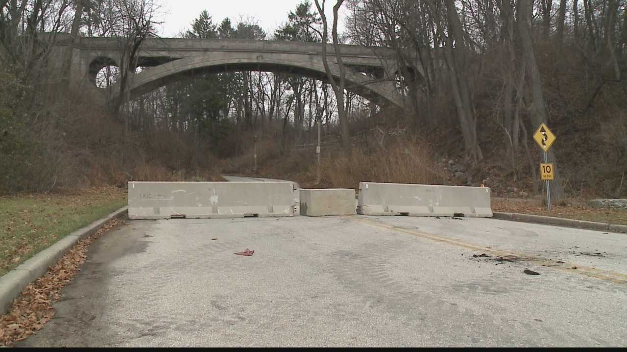 Chunks of debris from the foot bridge in Lake Park has forced park officials to barricade the road, making it an inconvenience for drivers and park goers.