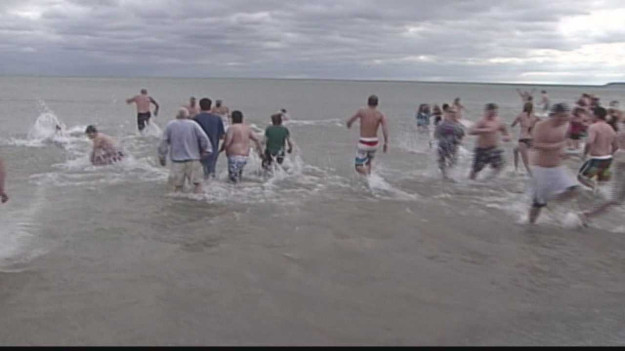Firefighters are preparing for the annual Polar Bear Plunge at Bradford Beach in Milwaukee.