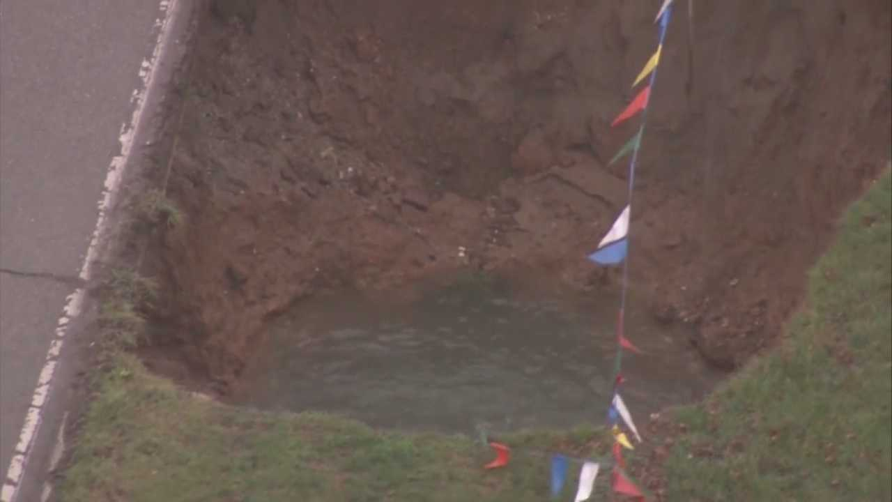 "MSD called the hole a ""cave in"" and said it was not caused by rain. MSD said it's the result of a hole in a sewer pipe."