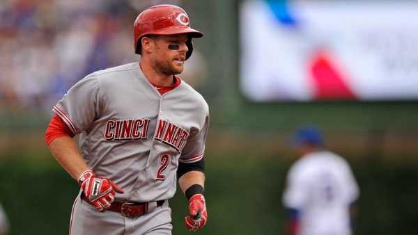 Cincinnati Reds' Zach Cozart rounds the bases after hitting a two-run home run during the second inning of a baseball game against the Chicago Cubs Tuesday, July 5, 2016, in Chicago. (AP Photo/Paul Beaty)