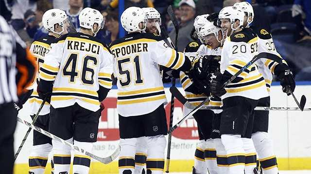 Bruins tied for first after beating Lightning in overtime