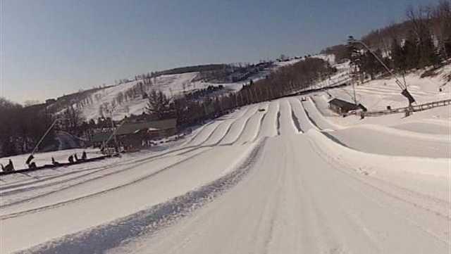 Riding Down Seven Springs Snowtubing Course