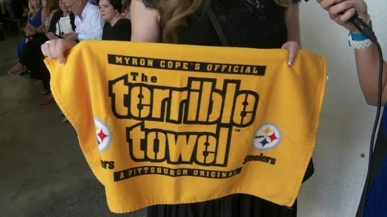 A Pittsburgh fan holds a Terrible Towel to support the Steelers.