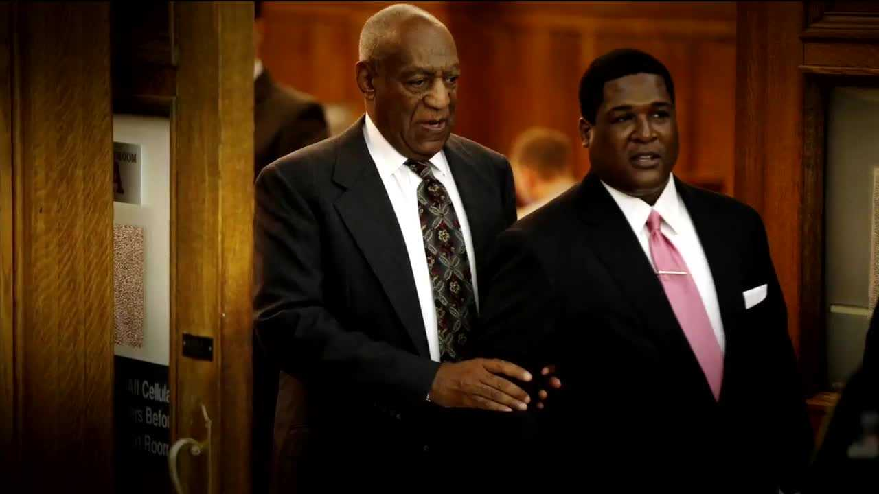 Bill Cosby in court, accompanied by an attorney.