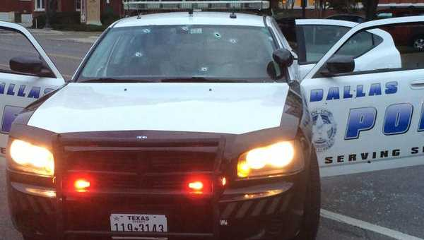 Bullet holes in a Dallas squad car. (Dallas Police Department)