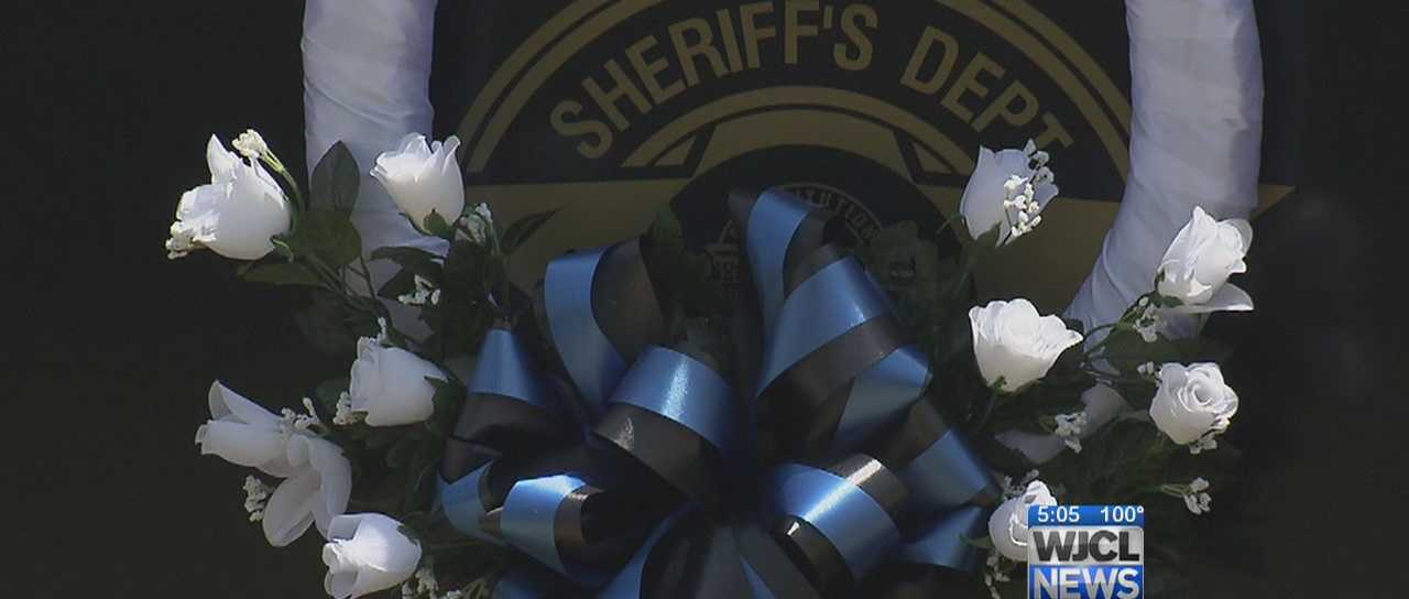 Montgomery County Sheriff, Ladson O'Connor was killed Tuesday during a high speed chase through several counties. Those he protected are now watching over his family and fellow deputies.