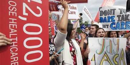 "Jessica Ellis, right, with ""yay 4 ACA"" sign, and other supporters of the Affordable Care Act, react with cheers as the opinion for health care is reported outside of the Supreme Court in Washington. (AP Photo/Jacquelyn Martin)"
