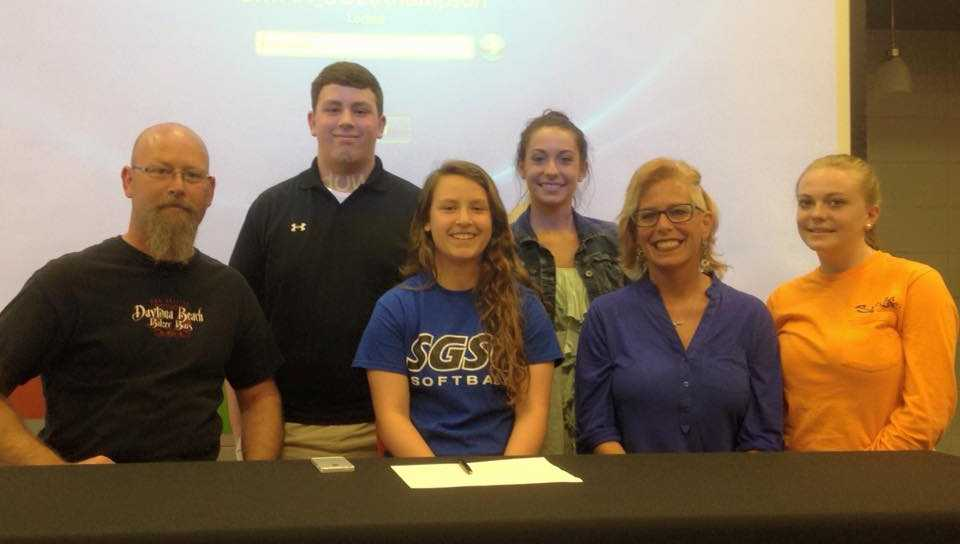 Three local student-athletes sign on Wednesday.