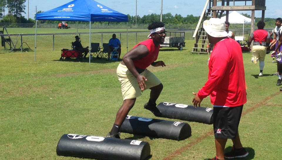 High school football players work out for several colleges