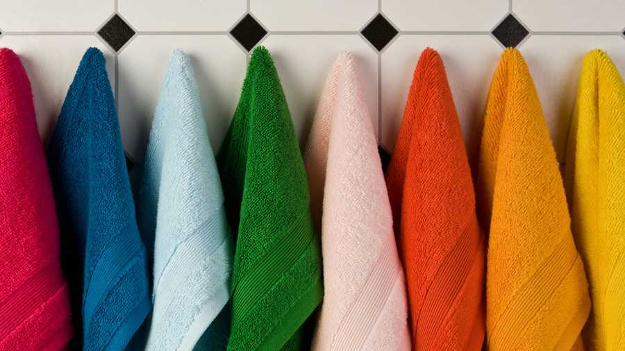 Multi-coloured towels hanging up